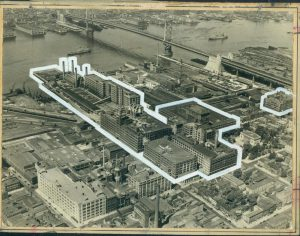A black and white aerial image of the Camden waterfront with the former RCA-Victor buildings highlighted