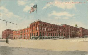 Color postcard depicting a large red building.