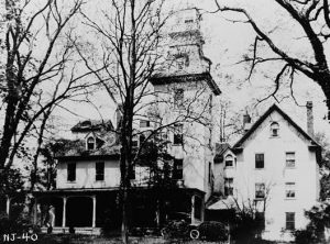 A black and white photograph of the manor house at the Batsto iron plantation, in its late ninenteenth century Italianate form.