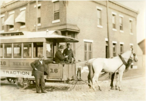 black and white photo of a horse drawn streetcar