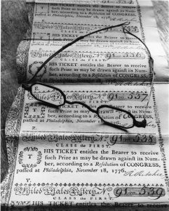 A black and white photograph of United States Lottery tickets.