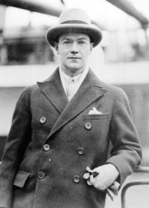 a black and white photograph of Philip Barry wearing an overcoat and bowler hat.