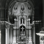 A black and white photograph of the alter at the Church of the Gesu