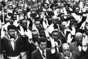 A black and white photograph of a large crowd of African American men in Masonic dress