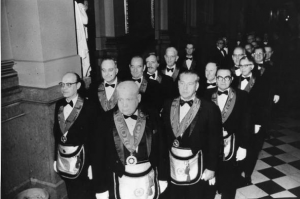 A group of masons in line inside the Masonic Temple