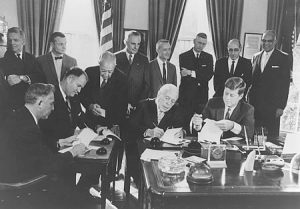 Three basin state governors join President John F Kennedy is signing the DRBC compact.