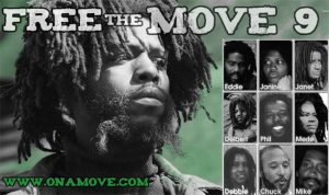 a poster urging the release of the nine MOVE members held in prison, with a photograph of each