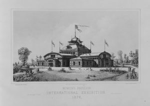 A black and white illustration of the Women's Pavilion. The large building has rounded roof lines and a prominent cupola. The roof is adorned with five flags.