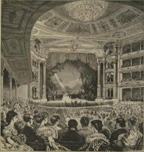 A black and white illustration of a large well-dressed audience watching a show at the Academy of Music