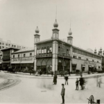a black and white photograph of a former rail station converted into a department store.