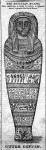 A black and white illustration of a heavily decorated mummy coffin in the shape of a human