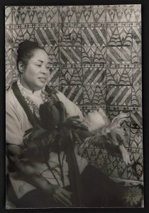 "a black and white photograph of actress Juanita Hall portraying the character ""Bloody Mary"" from South Pacific"