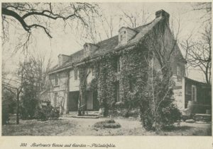 Scan of a postcard that shows, in black and white, the home of John Bartram. The home is a large, three story structure surrounded by ample grounds and many trees.