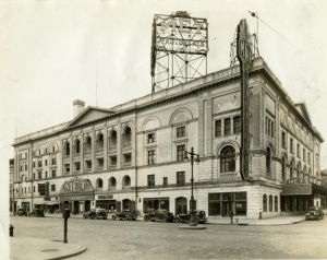a black and white photograph of a large opera house with a billboard-style sign above reading The Met