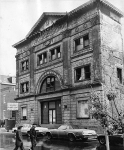 a black and white photograph of Musical Fund Hall in a state of disrepair