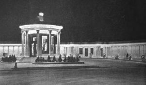 a black and white photograph of a gas station modeled after a Greek temple.