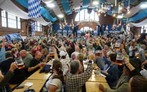 Color photo of Oktoberfest revelers inside Armory building, October 2016