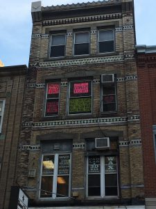 A color photograph of 704 Sansom Street in Philadelphia.