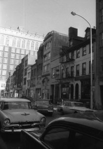 A black and white photograph of the 700 block of Sansom Street in Philadelphia.