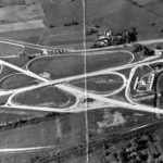 a black and white aerial photograph of a cloverleaf highway interchange in King of Prussia