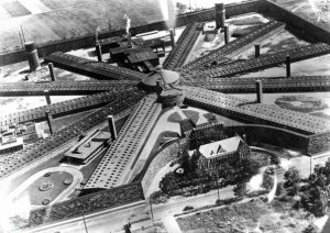 a black and white aerial photograph of Holmsburg Prison. It has ten wings connected in a radial pattern to a central hub and is surrounded by a wall.