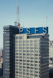 A color photograph of the PSFS building. The building is rectangular in shape, with a blue sign on the top with the letters P, S, F, and S in capital letters.