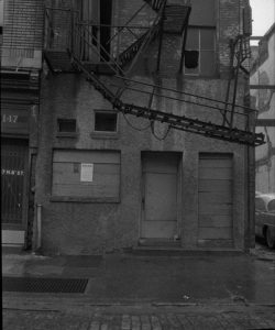 A black and white photograph of a rowhouse in Philadelphia to be demolished to make way for the Philadelphia Police Administration Building.