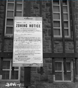 A black and white photograph of a zoning notice in Philadelphia.