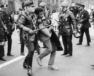 Photograph of Black Power demonstrator being arrested at rally