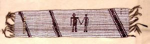 photograph of a woven wampum belt. the belt itself is a tan color with darker diagonal lines a a depiction of two human silhouettes holding hands