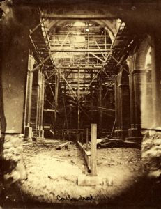 A black and white photograph of the interior construction of the cathedral.