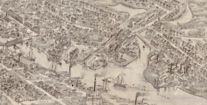 "This black and white map segment shows the main port area of Bridgeton. Several sailboats navigate an illustrated river labeled ""Cohansey River"" and approach a bridge. Intricately detailed buildings and streets appear on all sides of the river."