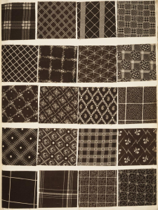 This photograph shows a page from a book of fabric samples. Each of the twenty samples has a different pattern, but they all have a brown and white color scheme.