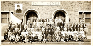 This undated black and white photograph shows a group of people outside Saint Agnes Saint John Nepomucene Roman Catholic Church in Philadelphia.