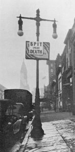 A photograph of a sign outside City Hall posted by the Philadelphia Board of Health to combat the influenza epidemic.