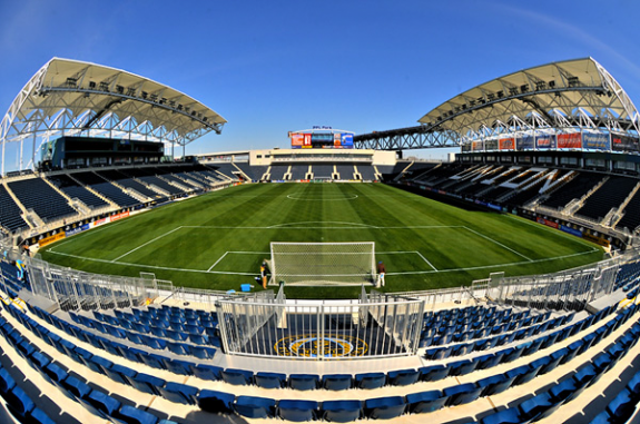 This color photograph shows the Talen Energy Stadium in Chester, Pennsylvania. The seats are blue. Several of them spell out