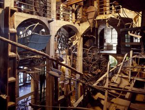 This color photograph shows several levels of the Mercer Museum. Objects and tools cover nearly every inch of open space, many of them made out of wood.