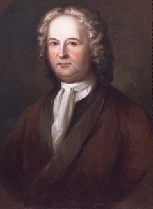 This color portrait shows James Logan. He wears a brown coat, white scarf and powdered wig.