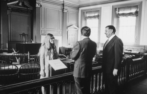 This black and white photograph shows Frank Rizzo and Richard Nixon at Independence Hall. They stand behind a wooden bannister while a tour guide behind the bannister looks on.