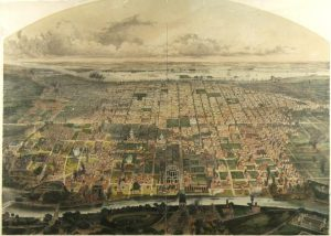A map of the Center City neighborhood of Philadelphia as it appeared in 1857, rendered in color. Dense residential housing is visible primarily between the Delaware River and Broad Street, while the area from Broad street to the Schuylkill River is dominated by industrial buildings and open space.