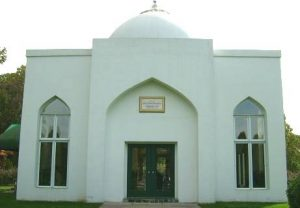 Color photograph of white mausoleum dedicated to M. R. Bawa Muhaiyaddeen
