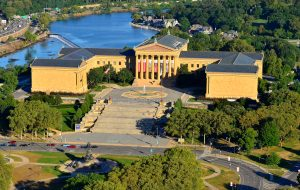 Aerial photograph showing the Philadelphia Museum of Art, a Greek Revival building, and surrounding environment.
