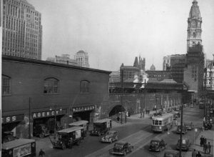 Photograph of Market Street and the Chinese Wall with trains running on it.