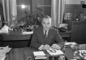 Photograph of Richardson Dilworth sitting at his desk