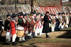 Reenactors at the Old Barracks Museum preparing to reenact the Battle of Trenton during Patriot's Week.