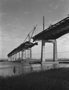 A 1951 photograph depicts the construction of a bridge along the New Jersey Turnpike.