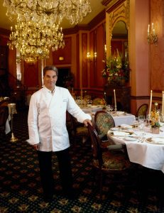Photograph of French chef George Perrier at his restaurant, Le Bec-Fin.